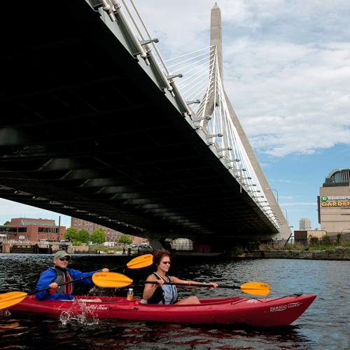 Kayaking under a bridge in Boston