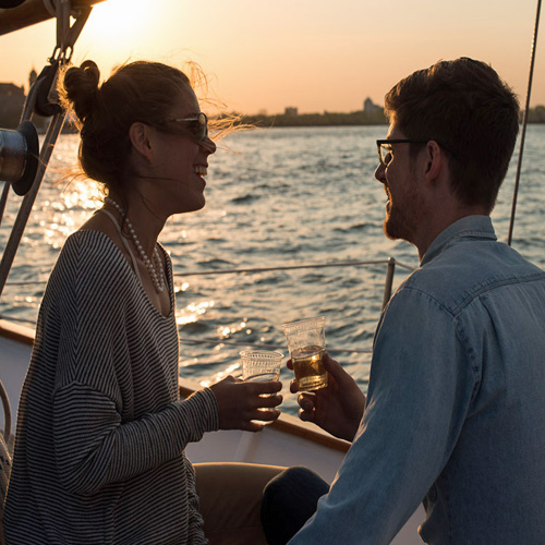 People on a Sailboat in Boston during Sunset