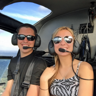 Couple enjoying Helicopter Tour of Pittsburgh