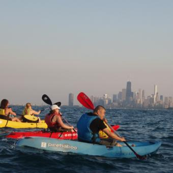 Skyline Backdrop During Night Paddle in Chicago