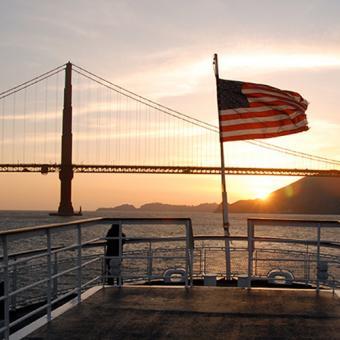 Sunset behind Golden Gate Bridge from Dinner Cruise