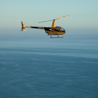 Helicopter Flight over ocean